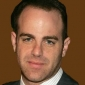 Aldo Rossi played by Paul Adelstein