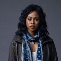 Evidence 'Evi' Ryan played by Vinessa Antoine