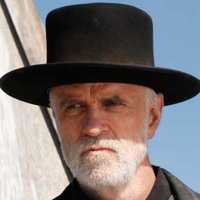 Reverend Nathaniel Cole played by Tom Noonan