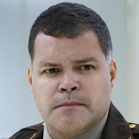 Sheriff Sworn played by Aaron Douglas