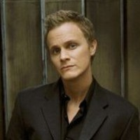 Adam Monroeplayed by David Anders