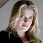 Tracy Strauss played by Ali Larter