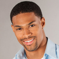 Travis played by Denzel Wells