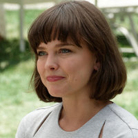 Laura Larson played by Allison Miller