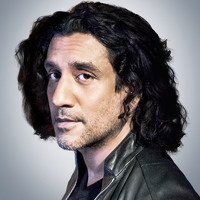 Julian Cousins played by Naveen Andrews