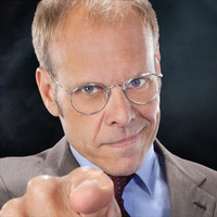 Commentator played by Alton Brown Image
