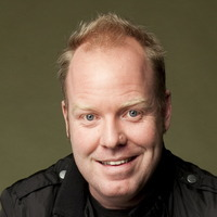 Greg played by Peter Helliar