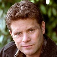 Mister Smithplayed by Sean Astin