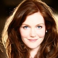 April Green played by Darby Stanchfield