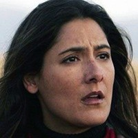Mimi Clark played by Alicia Coppola