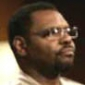 Court Bailiff played by Petri Hawkins-Byrd