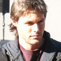 Mike Tracer played by Justin Bruening