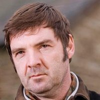Robert Timmins played by Brendan Coyle