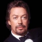 Tim Curryplayed by Tim Curry