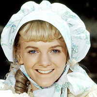 Nellie Oleson played by Alison Arngrim