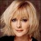 Herself - Presenter (12) played by Jane Moore