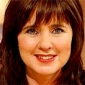 Herself - Presenter (14) played by Coleen Nolan