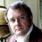 Mr. Bennetplayed by Hugh Bonneville
