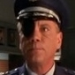 Commandant Edwin Spangler played by Daniel von Bargen
