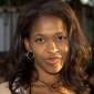 Kitty Kenarban played by Merrin Dungey