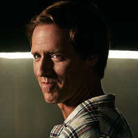 Russ played by Nat Faxon