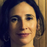 Stacey played by Michaela Watkins