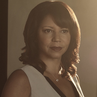 Adina Johnson played by Gloria Reuben