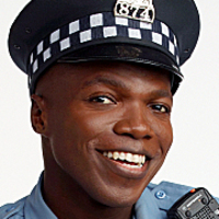 Officer Carl McMillan played by Reno Wilson