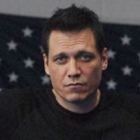 Bill Tench played by Holt McCallany