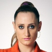 Kelly played by Lauren Socha