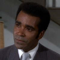 Barney Collier played by Greg Morris