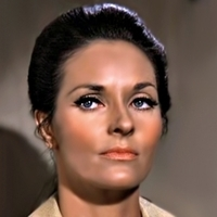 Tracey played by Lee Meriwether