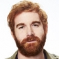 Bruce played by Andrew Santino