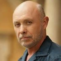 Dr. Neven Bell played by Hector Elizondo