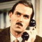 The Announcerplayed by John Cleese