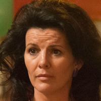 Debra Moone played by Deirdre O'Kane