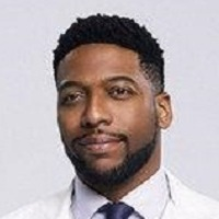 Dr. Floyd Reynolds played by Jocko Sims