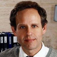 Dr. Larry Fleinhardt played by Peter MacNicol