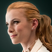 DR. Carrie Roman  played by Betty Gilpin
