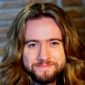 Himself - Presenter played by Justin Lee Collins