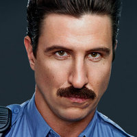 George 'Pornstache' Mendez played by Pablo Schreiber