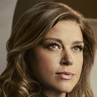 Kelly Grayson played by Adrianne Palicki