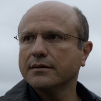 Carl Elias played by Enrico Colantoni