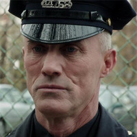Officer Patrick Simmons played by Robert John Burke