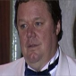 Den Perry played by Ted Robbins
