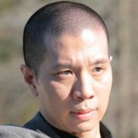 Bill Kim played by Reggie Lee