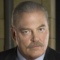 Warden Henry Pope played by Stacy Keach
