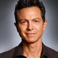 Dr. Jake Reilly played by Benjamin Bratt