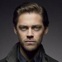 Malcolm Bright played by Tom Payne