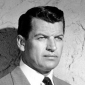 Jim Redigoplayed by Richard Egan